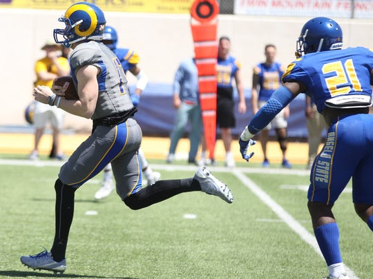 Angelo State University quarterback Austin Tracy (left)
