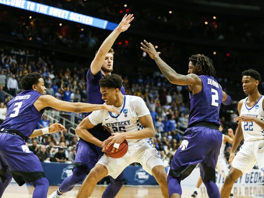 PJ Washington is pressured by Kansas State in their 2018 NCAA Tournament game.