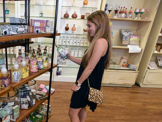 Lillie Faucheaux of New Orleans enjoys the new look of King Hardware and Gifts during a recent shopping excursion.