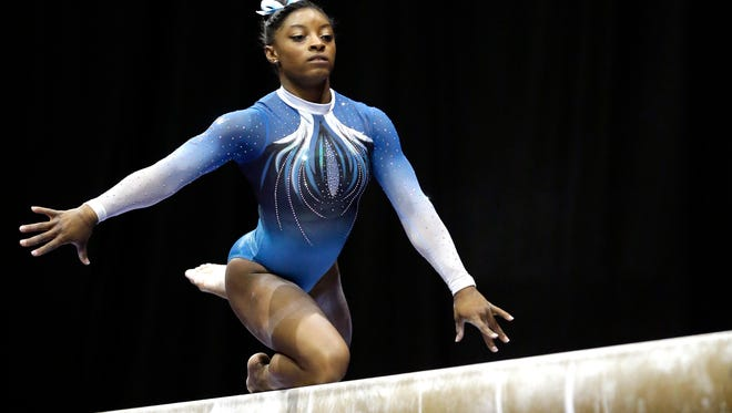 American gymnast Simone Biles competes on the balance beam.