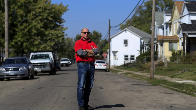 Gary Zaremba stands for a portrait outside of a house he oversees in Dayton, Ohio.