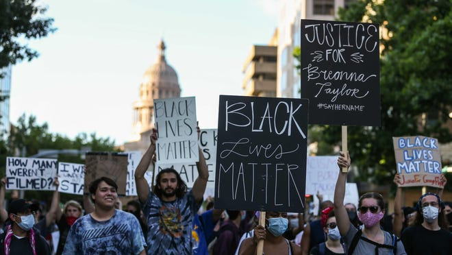 Protesters march from the Texas State Capitol to the Austin Police Department Headquarters during a Black Lives Matter rally in Austin on June 4, 2020.