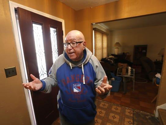 Retired Keyport teacher Dick Woolf at his home.  Middletown