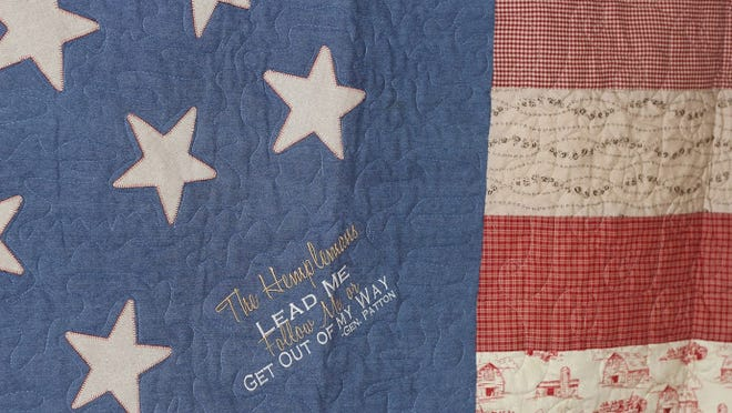 A homemade U.S. flag quit for the Hempleman family of Fort Thomas is an example of quilts made by a Disabled American Veterans auxiliary group as a way to honor veterans and raise funds to assist veterans.
