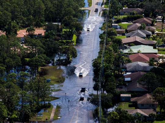 Aerial view of East Terry Street in Bonita Springs on Saturday, Sept. 16, 2017, six days after Hurricane Irma.  (AP Photo/Naples Daily News, Nicole Raucheisen)