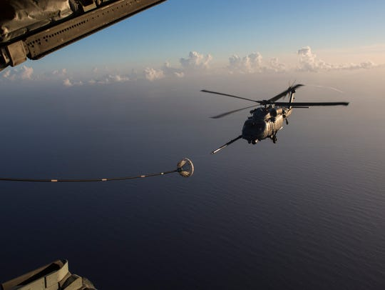 An HH-60G Pave Hawk refuels from an HC-130P/N King