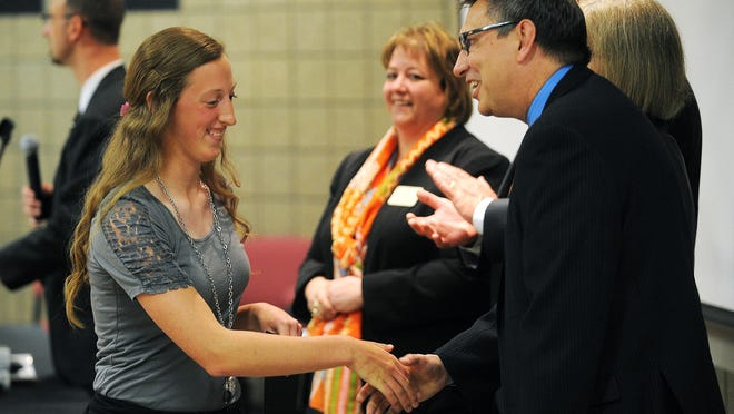 Katie Timm, a Build Dakota Scholarship winner, shakes hands with Jeff Holcomb, president of Southeast Technical Institute, during an award ceremony for Build Dakota Scholarship winners on Friday at Southeast Technical Institute in Sioux Falls.