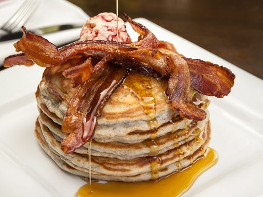 The atole piñon hotcakes topped with strawberry butter and bacon from Sierra Bonita Grill in Phoenix.