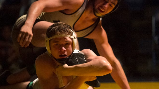 Chase Zahalka of Fort Myers wrestles Francisco Jaramillo of Golden Gate in the 2A-3 regional finals on Saturday, March 7, 2015 at Charlotte High School in Punta Gorda. Zahalka won the match to take first in the region.