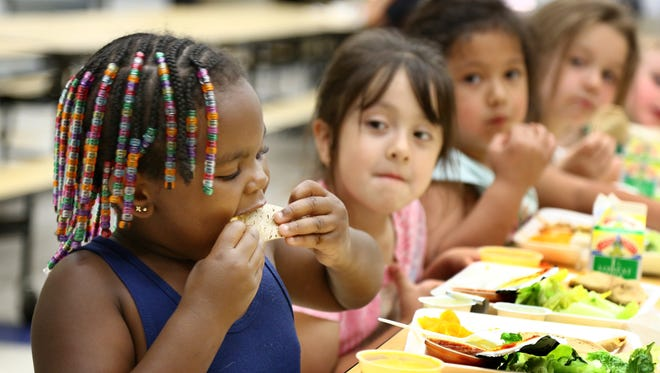 Students eat lunch at Irving Elementary School on June 26, 2014, in Sioux City, Iowa.