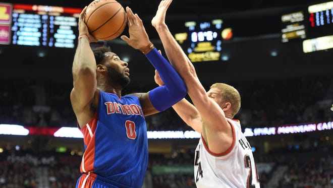 Detroit Pistons center Andre Drummond (0) drives to the basket on Portland Trail Blazers center Mason Plumlee (24) during the first quarter of an NBA basketball game in Portland, Ore., Sunday, Nov. 8, 2015. (AP Photo/Steve Dykes)