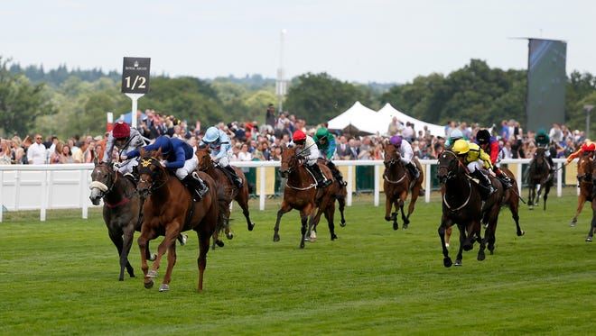 Acapulco, ridden by Ryan Moore, wins the Queen Mary Stakes during Royal Ascot's 2015 meeting.