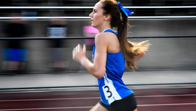 Memorial's Presley Warren set a meet record in the girls 1600m run at the Southern Indiana Athletic Conference track meet held at Evansville's Central High Stadium Thursday, May 11, 2017.