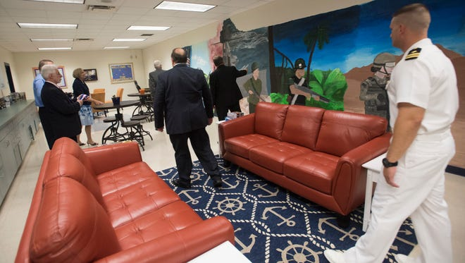 Members of the Escambia County School District board and other visitors take a tour of the new quarterdeck at Escambia High School on Tuesday, Sept 19, 2017.