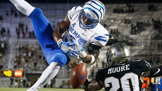 University of Memphis receiver Anthony Miller (left) drops a touchdown pass while defended by University of Central Florida defensive back Brandon Moore (right) during fourth quarter action in Orlando, Fl., Saturday, September 30, 2017.