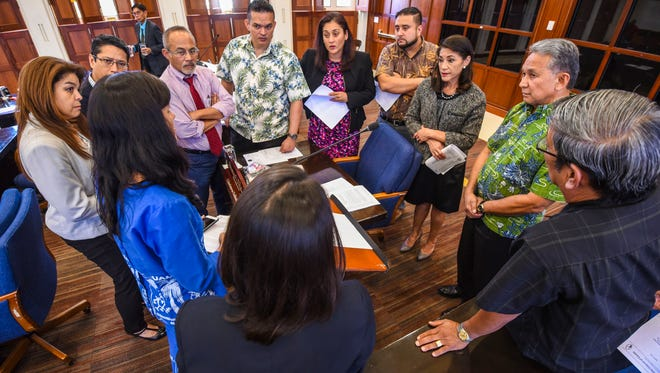 Lawmakers' attentions are to Vice Speaker Therese Terlaje during an impromtu discussion on the floor of the Guam Legislature on Thursday, Mar. 1, 2018.