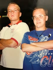 Chris Mackiewicz, left, and Daddy Duty columnist Tim Walters in Miami at a Marlins-Cubs game in 1996.