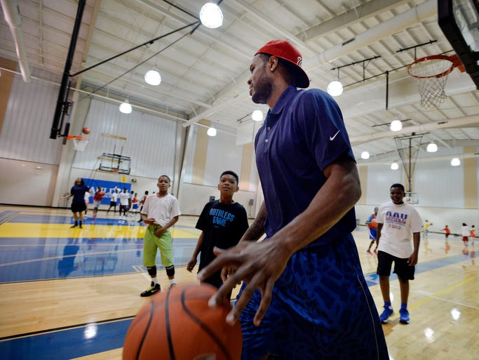 Washington Wizards forward and former Clemson standout Trevor Booker plays one-on-one with campers during the Trevor Booker Basketball Camp at the Mauldin Recreation Center on June 9, 2014.