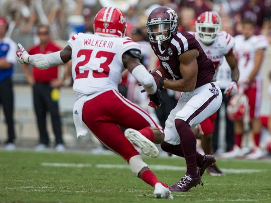 UL's Tracy Walker tries to make a stop on Texas A&M