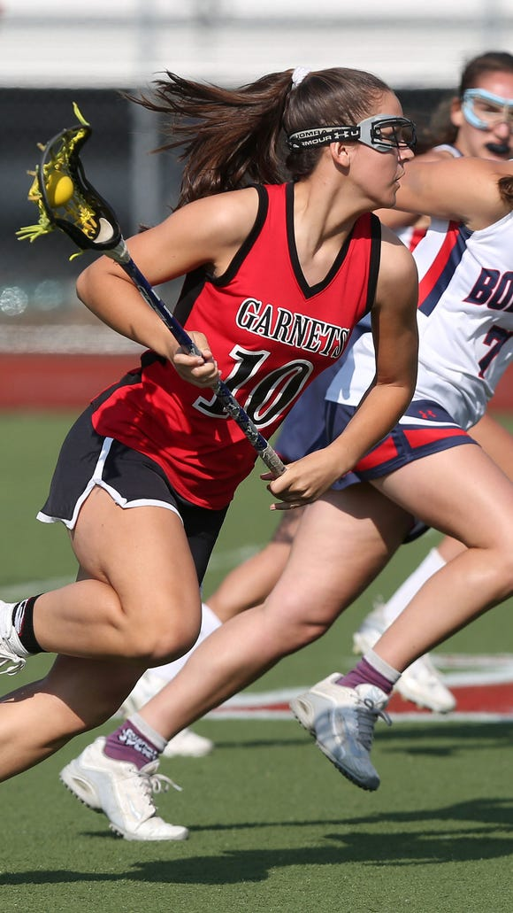 Rye's Leah Kenny (10) drives to the goal in front of Byram Hills' Lindsey Grotta (7) during girls lacrosse action at Byram Hills High School in Armonk May 10, 2018. Rye won the game 13-12.