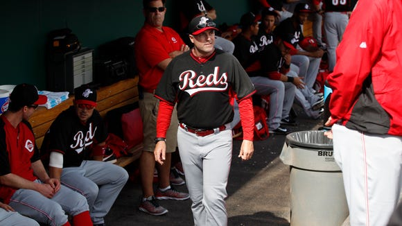 Reds manager Bryan Price walks through the dugout before the start of a game against the Cleveland Indians at Goodyear Ballpark on Feb. 26.