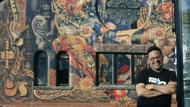 Wall Therapy co-curator Erich Lehman stands in front of The Playhouse/Swillburger on Clinton Avenue.