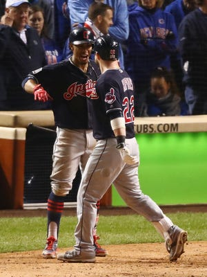 Cleveland's Francisco Lindor and Jason Kipnis (right) celebrate after Kipnis hit a home run in the seventh inning against the Chicago Cubs in Game 4 of the World Series at Wrigley Field on Saturday night.