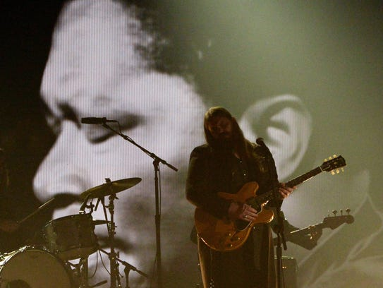 Chris Stapleton (pictured) performs with Gary Clark