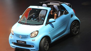 A Smart fortwo cabrio car on display at the Daimler AG booth during a press day ahead of the Frankfurt Auto Show