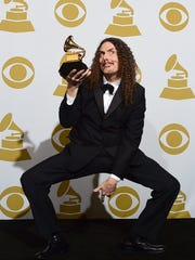 "'Weird Al"" Yankovic poses in the press room after winning Best Comedy Album for ""Mandatory Fun"" during the 57th annual Grammy Awards in Los Angeles, California on February 8, 2015."