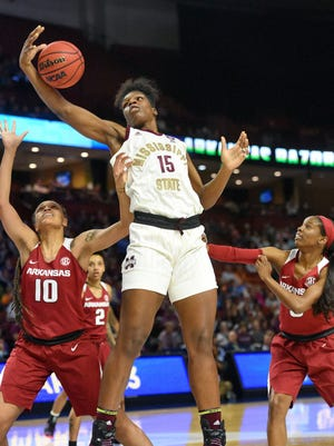 FILE - In this March 10, 2019, file photo, Mississippi State's Teaira McCowan (15) grabs a rebound in front of Arkansas' Kiara Williams (10) and Malica Monk during the first half of an NCAA college basketball championship game in the Southeastern Conference women's tournament, in Greenville, S.C. Mississippi State earned one of four top seeds in the NCAA Tournament, giving the program a decent chance to get back to the national championship game for a third straight season. (AP Photo/Richard Shiro, File)