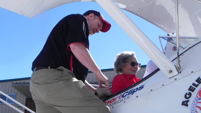 Cathy Baker Ross prepares to fly aboard a 1940s Boeing Stearman airplane at Tiger Field near Fernley on June 22.
