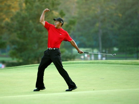 Tiger Woods in his iconic red shirt, worn only on the Sunday of a tournament.