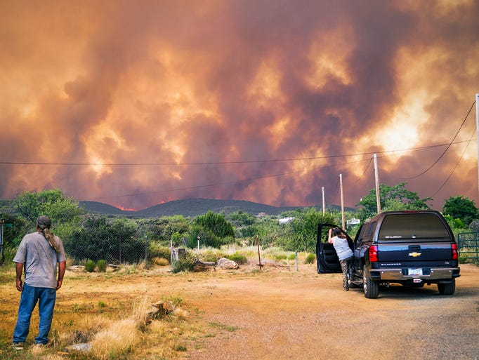Don Sandy (left) watches the Goodwin Fire from his