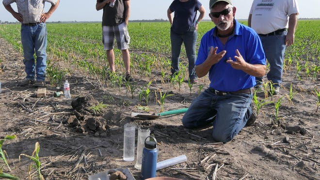 Ray Archuleta of Understanding Ag explains regenerative soil management practices to farmers in Hutchinson.