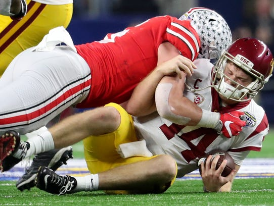 Dec. 29, 2017; Arlington, TX, USA:  Ohio State defensive end Sam Hubbard (6) sacks USC quarterback Sam Darnold (14) during the 2017 Cotton Bowl at AT&T Stadium. Ohio State won 24-7.