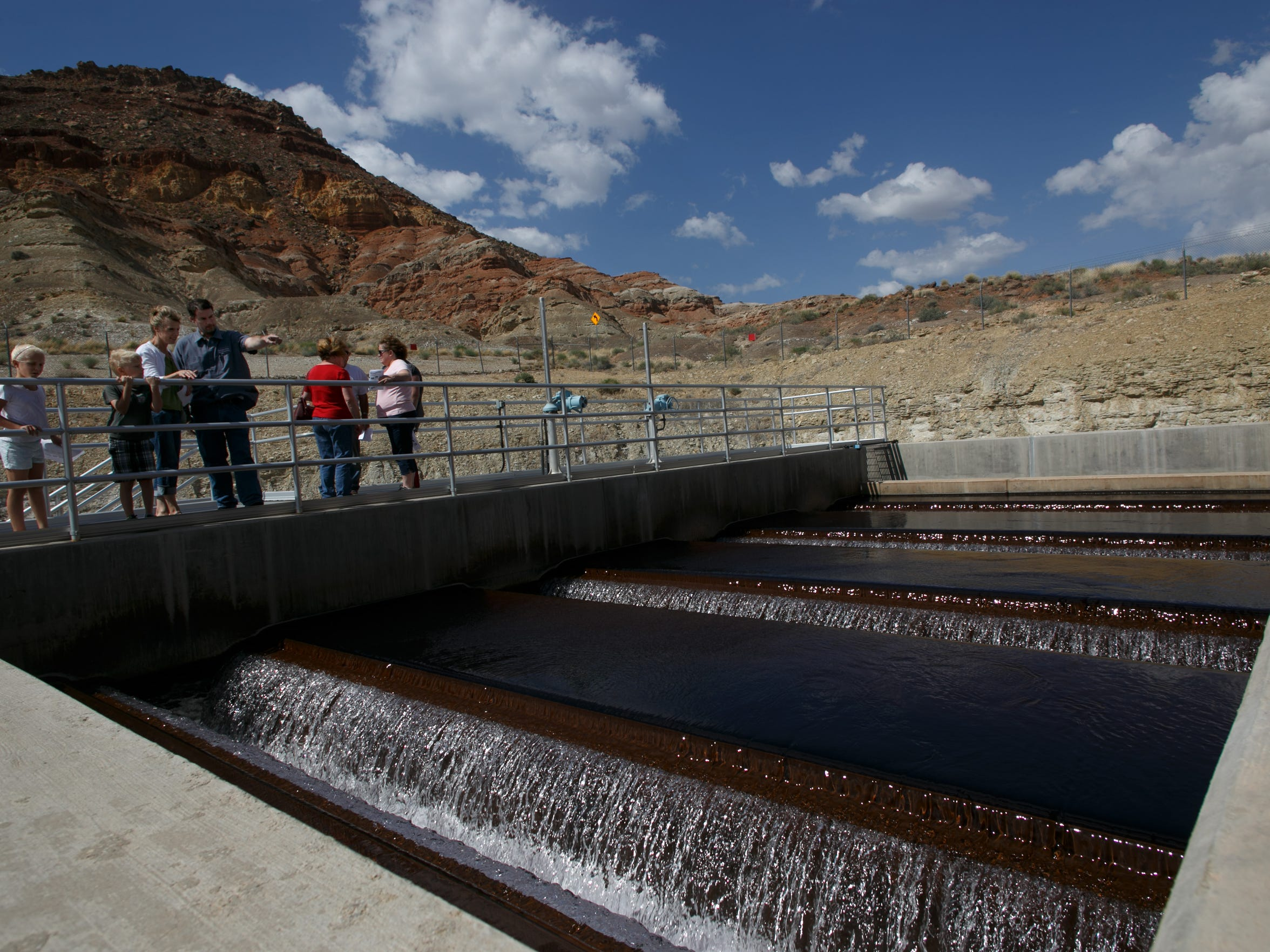 "Tim Reese, a plant operator at the Quail Creek Water Treatment Plant for the Washington County Water Conservancy District, fourth from left, describes the process behind the treatment of Washington County's drinking water during a tour of the water treatment facility Tuesday, May 6, 2014. Similar tours are being offered this week as part of the 2015 ""Water Week"" celebration in Washington County. Jud Burkett / The Spectrum & Daily News"