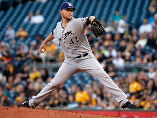 Milwaukee Brewers starting pitcher Jimmy Nelson delivers during the first inning of a baseball game against the Pittsburgh Pirates in Pittsburgh, Friday, April 15, 2016. (AP Photo/Gene J. Puskar)