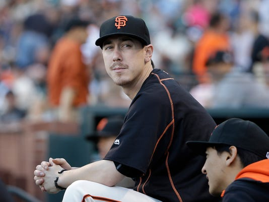 FILE - This July 28, 2015 file photo shows San Francisco Giants pitcher Tim Lincecum looking on during a baseball game against the Milwaukee Brewers in San Francisco. The two-time NL Cy Young Award winner will pitch for major league clubs in a showcase event Friday, May 6, 2016 as he attempts to make a comeback bid from hip surgery last year. (AP Photo/Jeff Chiu, file)