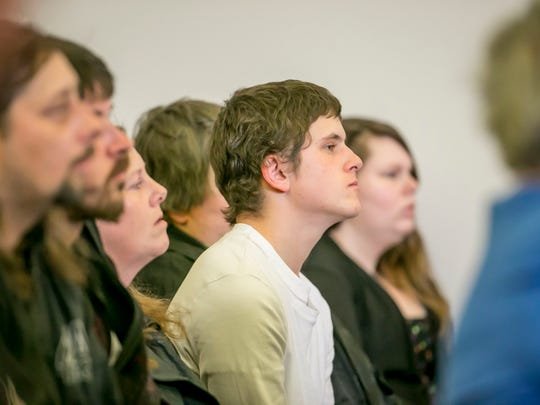 Robert Bellevue, 21, of St. Albans waits for his arraignment