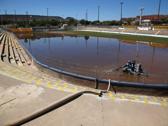 A large pump is used to remove flood water from the Sunbowl and into the roadway Thursday, Aug. 28, 2014.