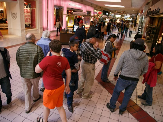 Shoppers make their way through the Red Cliffs Mall.