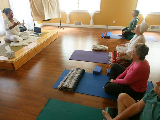 Benja Peterson leads her breath work and meditation class at Benja's Downtown Yoga Studio on Friday.