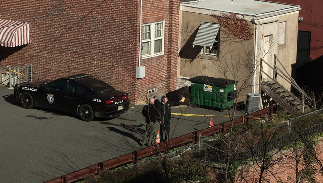 Investigators at the scene after the discovery of a body behind a building on Schuyler Place in Morristown. November 17, 2015, Morristown, NJ.