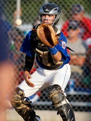 Dover catcher Jon Carson receives a throw to start a triple play in the seventh inning Thursday.