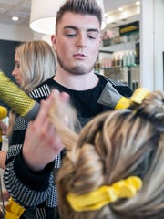 Stylist Tanner Roberts tends to Jennifer Rice on Thursday afternoon at Dry Bar. 1/21/16
