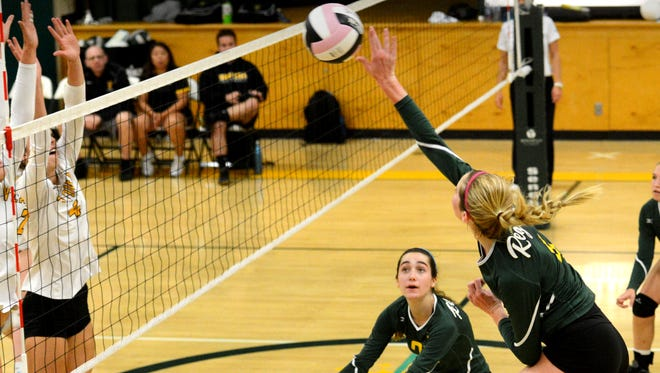 La Reina's Ava Hudson powers the ball over the net in a volleyball match Wednesday night against Ventura.