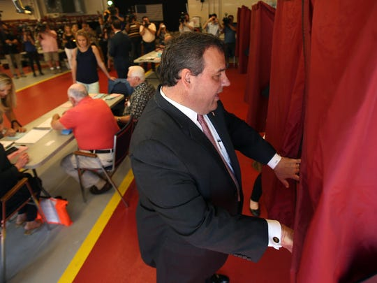 Gov. Chris Christie heads into the voting booth to vote in the Primary Election at the Emergency Services Building in Mendham Twp.