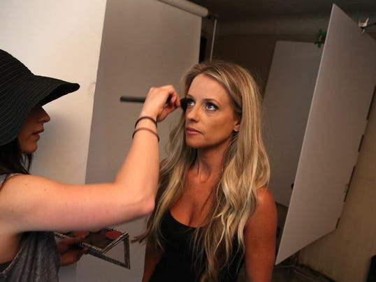 (L to R) Makeup artist Miranda Knott, 31 of Grosse Pointe gets Nicole Curtis of the show Rehab Addict on