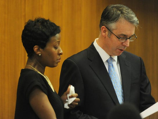 A tearful Ingrid Ellerbe stands by Assistant Prosecutor